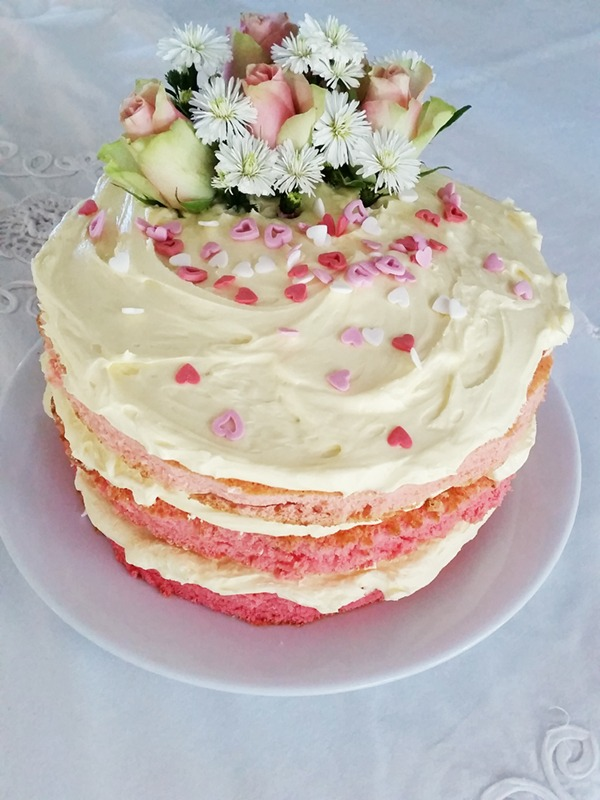 The mother of all pink ombré cake (s) with butter icing and roses