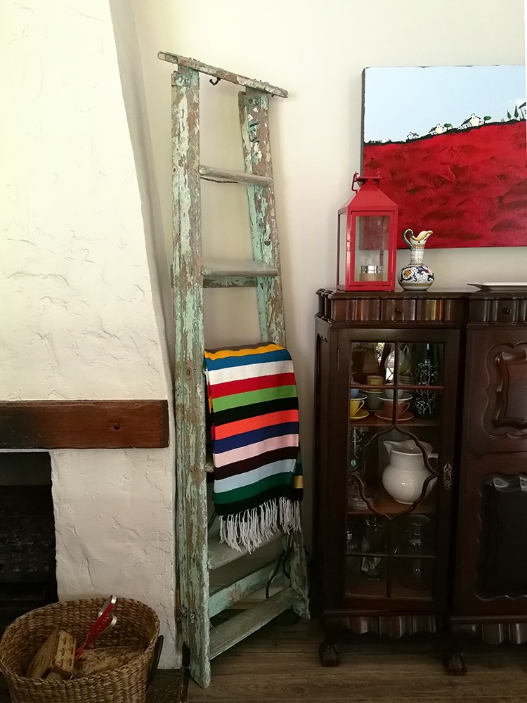 fireplace, ladder and blanket