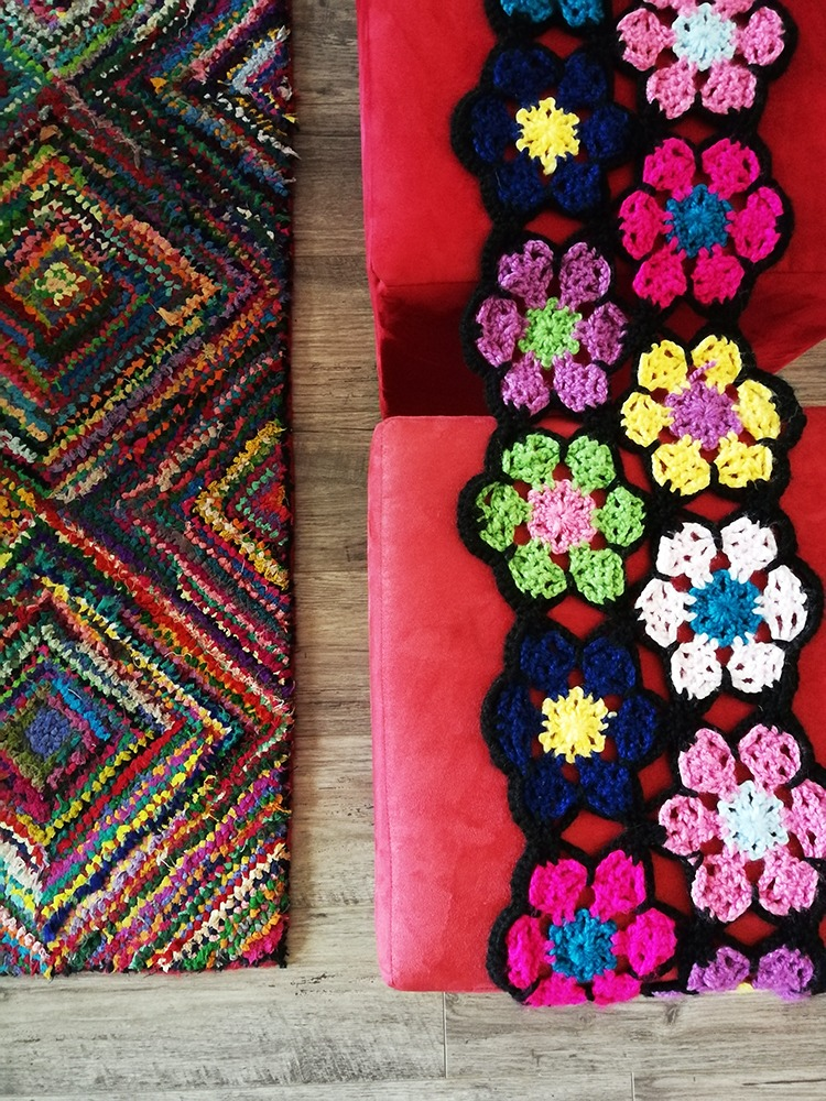 colourful carpet and crochet blanket